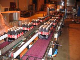 Конвейер для разделения потока продукции на два ряда.
